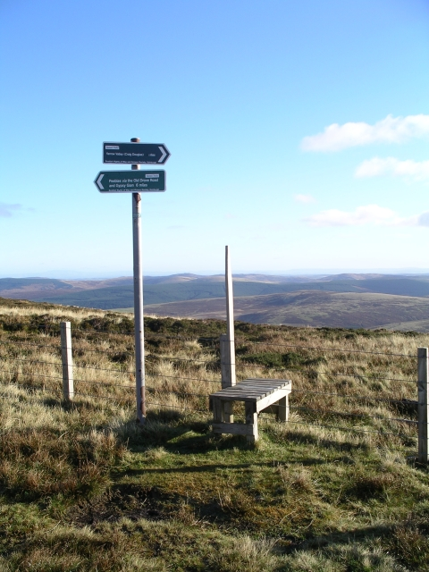 Signpost and stile, Birkscairn hill