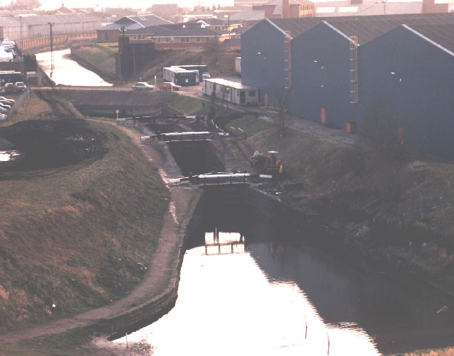 Former glassworks beside the restored New Double Locks of the Sankey Canal