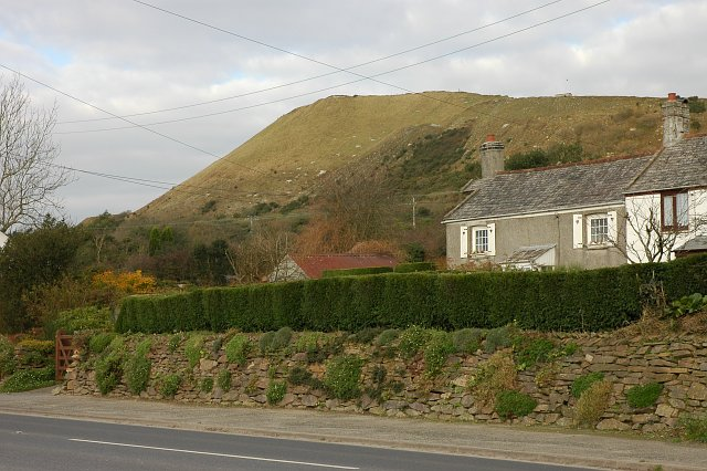A house by the roadside and china clay waste tip