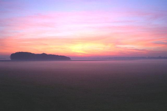 Sunset over a misty Halsall Moss