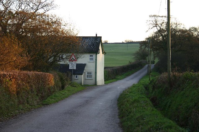House with bridge over disused railway near Rawstone Moors