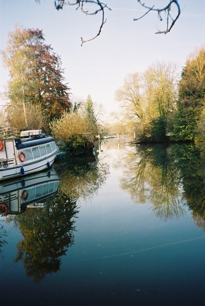 River Thames - boat and trees reflected