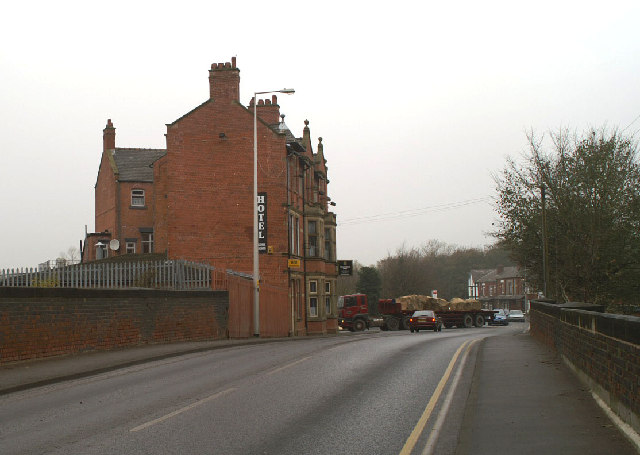 The Coaching Inn,with lorry carrying stone beyond