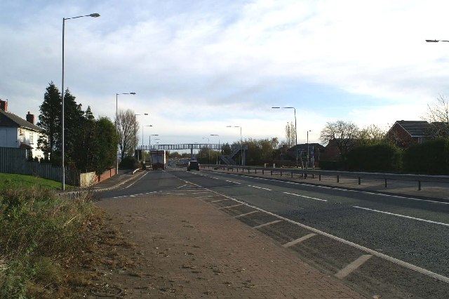 Junction and footbridge on the East Lancs Road