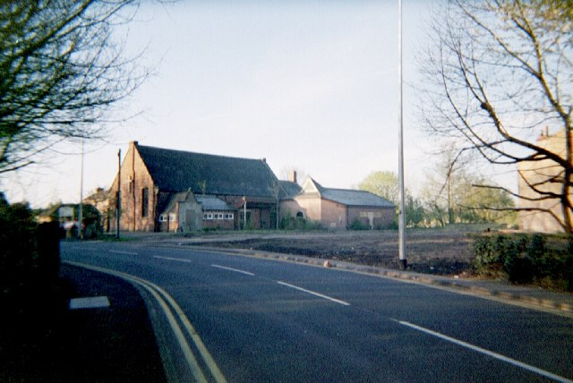 Cleared site of 232-240 Warrington Road, revealing St. Mary's Church