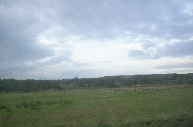 Scrubland and slagheap in distance