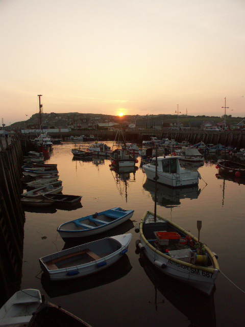 Boats in West Bay harbour at sunset