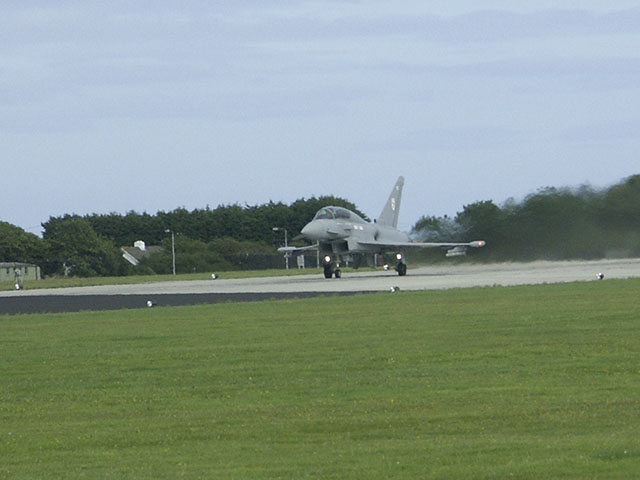A Eurofighter Typhoon awaits take-off clearance at the end of  runway 30, RNAS Culdrose.