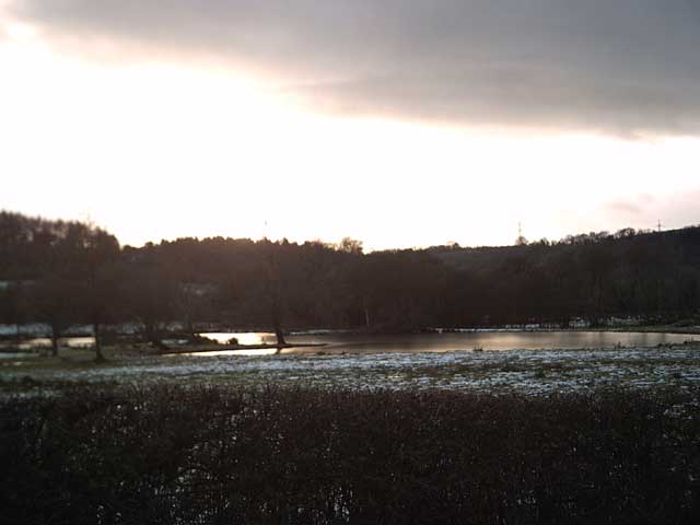 Exebridge: Frozen pond near sunset.