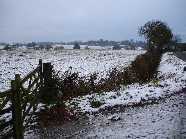 Wintery view across the fields towards Astley Church