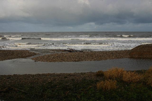Burn of Tynet enters Spey Bay