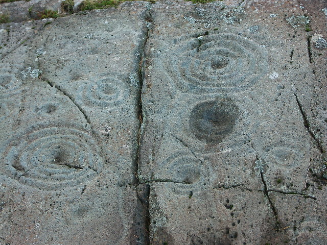 Cup and Ring markings on inscribed stone
