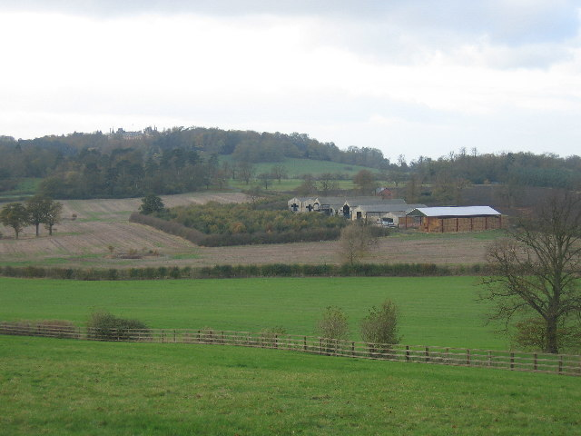 Barns near Wormstone with Waddesdon Manor on sky line