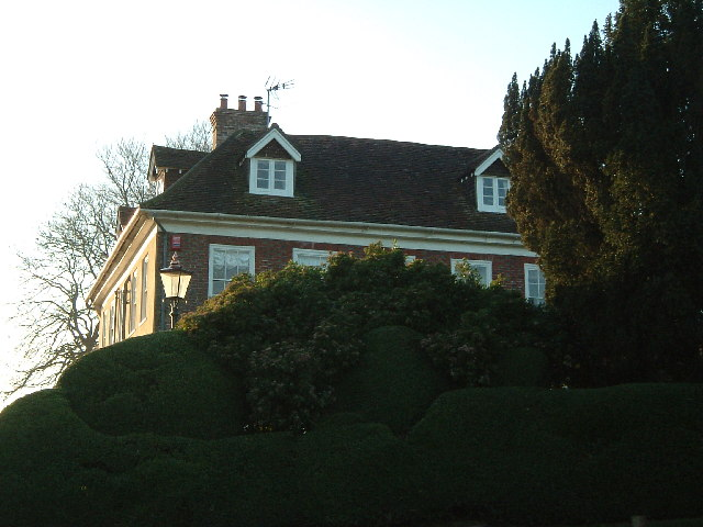 The Farmhouse Behind The Hedge