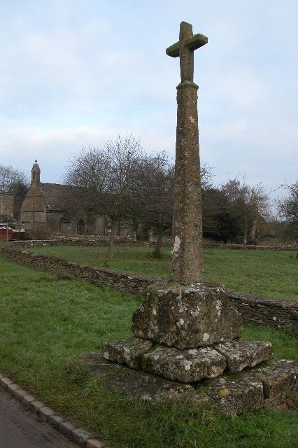 Cross and church in the village of Condicote