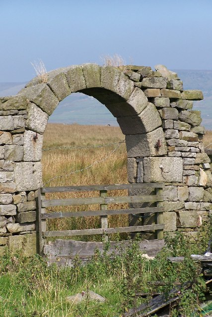 Remains of barn doorway and moorland