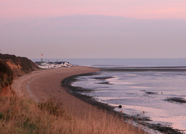 Meon Shore Chalets and shoreline at dusk