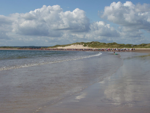 Runners on Beadnell beach