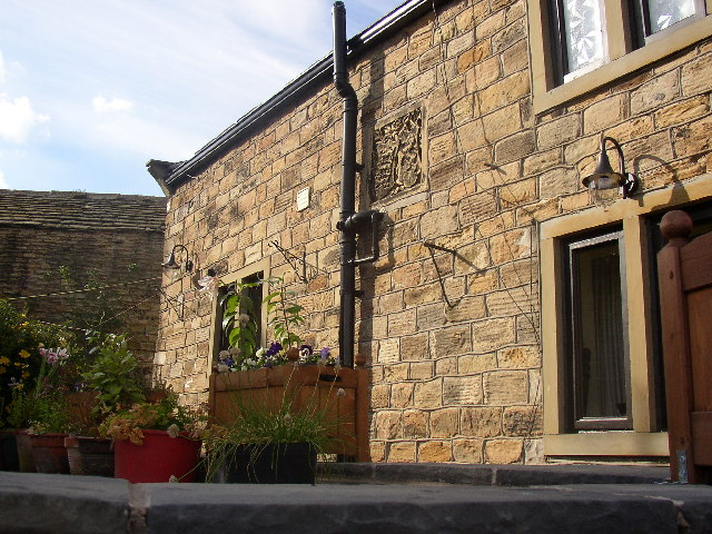 Carved stone on cottage, High Hoyland