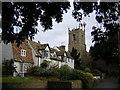 TL2572 : Hartford church and cottages by John V Nicholls