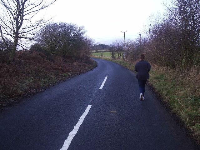 Runner on minor road, near Bardon Mill