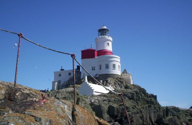 The Skerries Lighthouse (Ynys Y Moelrhoniaid) off NW Anglesey.