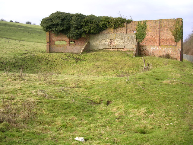 Wall of unknown purpose (rifle range butt?), below Poundbury hillfort