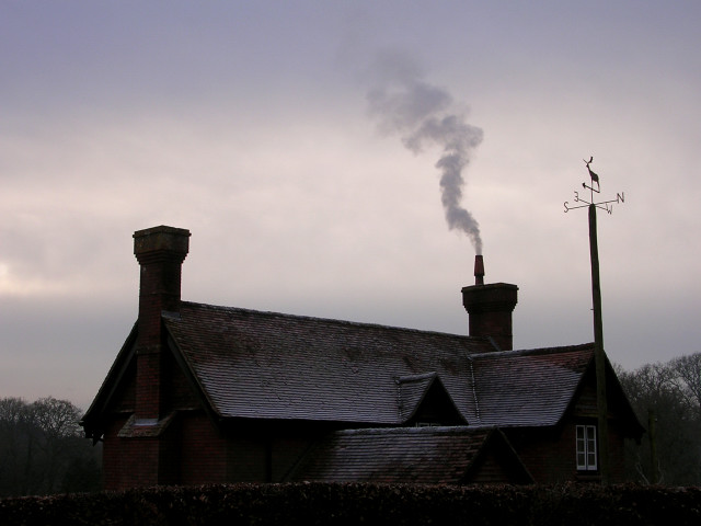 Chimneys and wind vane at Denny Lodge, New Forest
