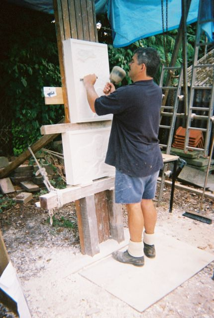 A Sculptor working on a War Memorial to Women who lost their lives in the War