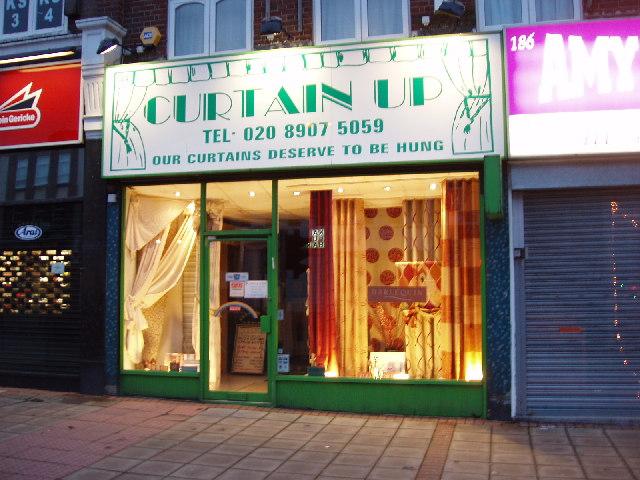 Curtain shop in Kenton, lit up at night