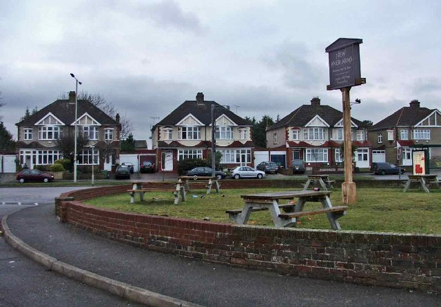 Garden of New River Arms, with pub sign and houses in High Road, Turnford, in background