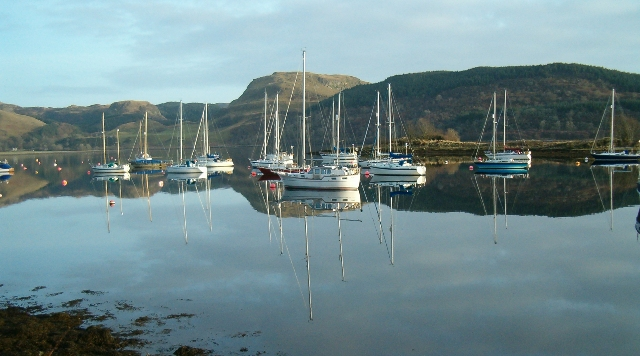 Yachts moored in front of Eilean Inshaig