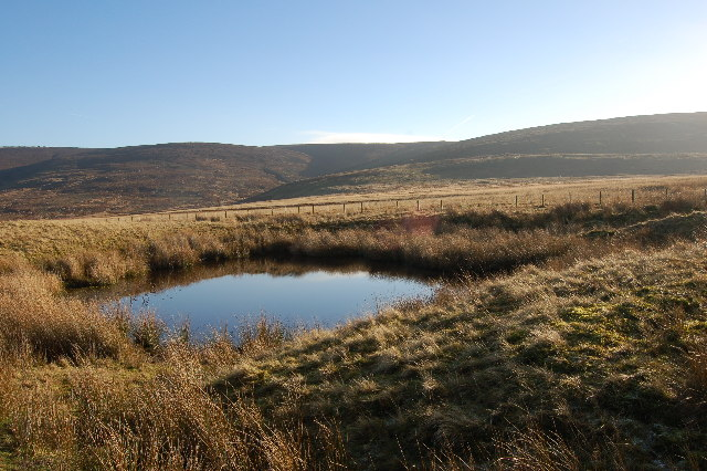Pond below Isle of Skye Farm withCatshaw Greave in the background