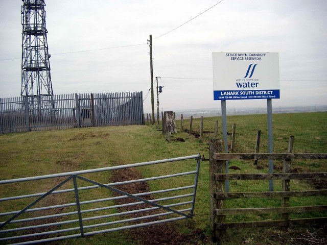Trig point , radio mast and reservoir at Carnduff