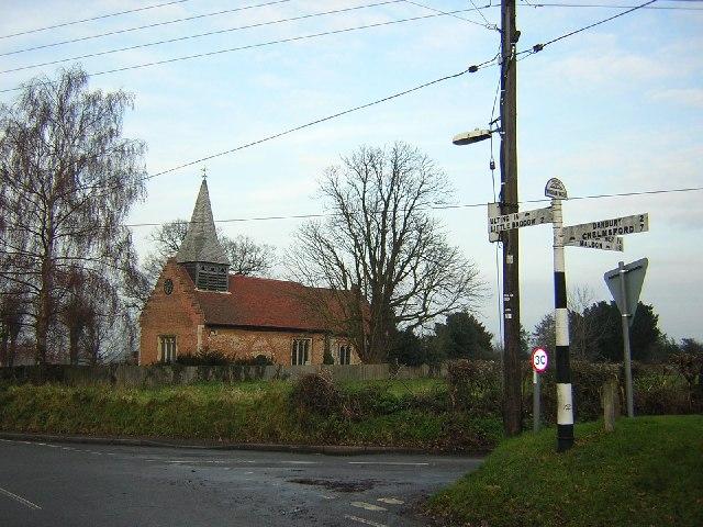 Parish church and signpost at Woodham Walter