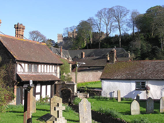 Dunster Priory churchyard, old house and view to Castle