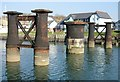 SX4952 : Piers from an old Railway Bridge by Tony Atkin
