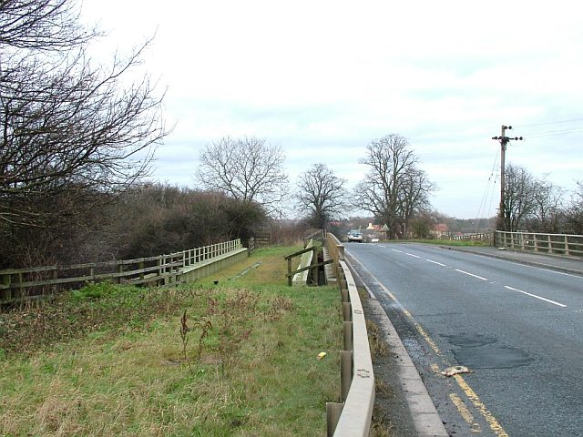 Road and former railway bridge over the A1