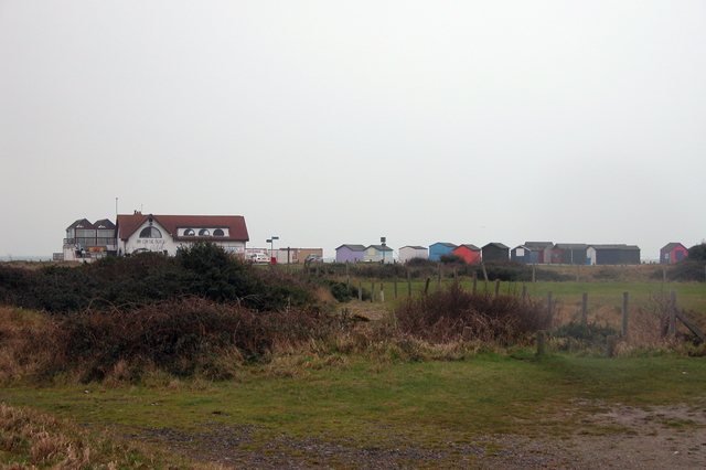 Beach cafe and beach huts, seen from the land side, Hayling Island.