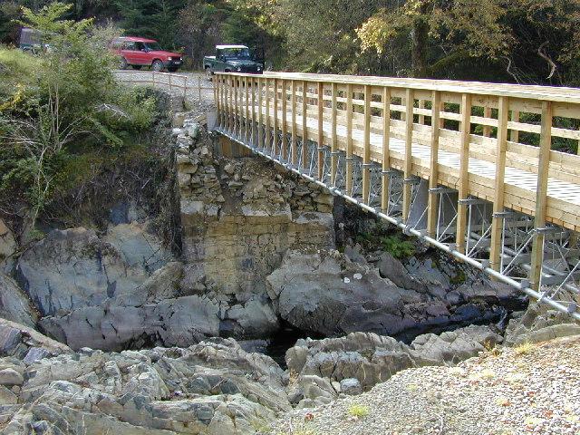 Road bridge replaced with footbridge.