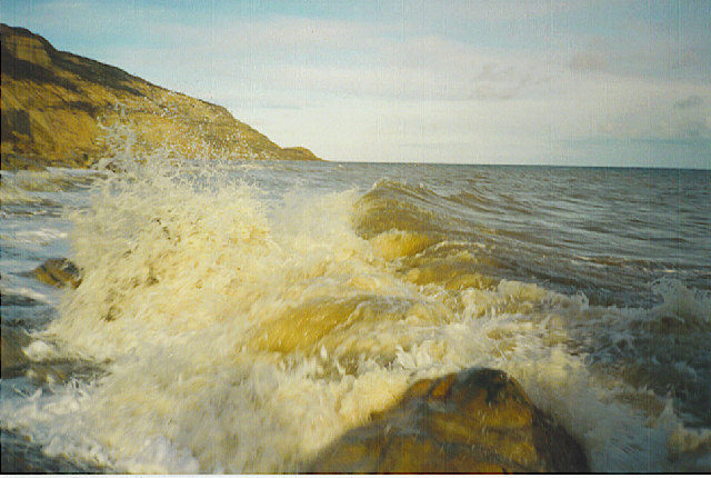 Waves crashing on the Rocks at the foot of Fairlight Glen