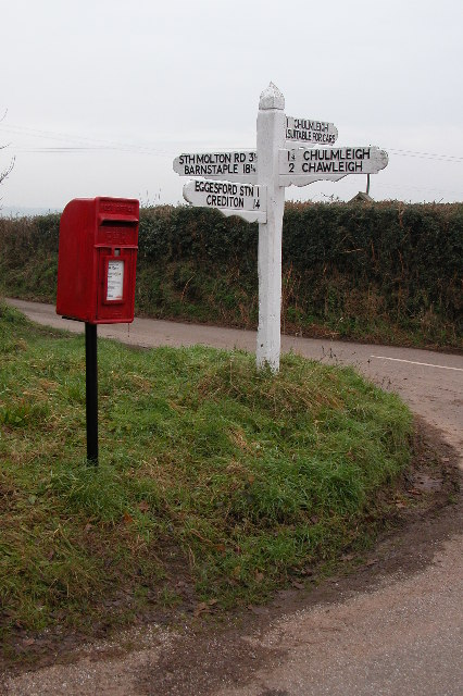 Signpost and postbox at Chawleigh Week Cross