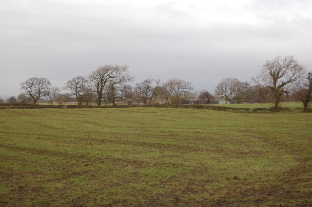 Farm land to the north of the road from The Plough at Eaves to the A6
