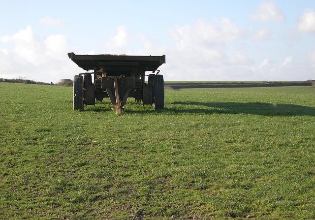 Trailer in a grass field.