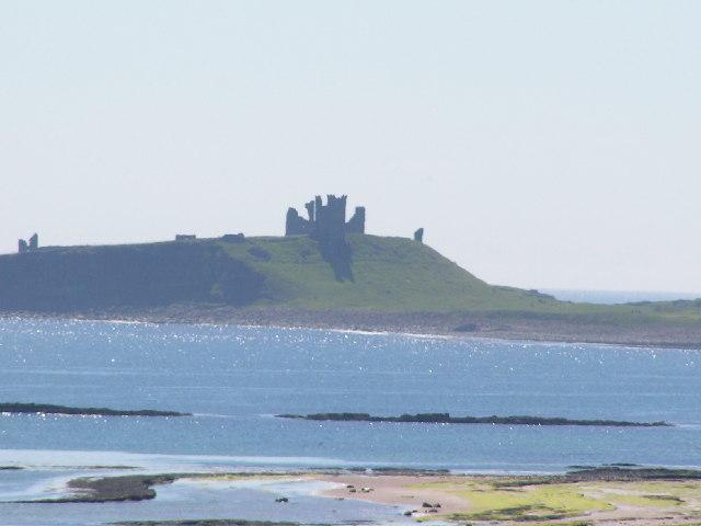 Dunstanburgh Castle across Embleton Bay