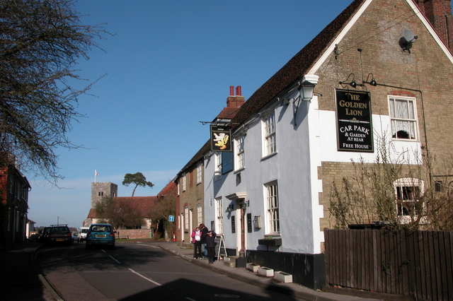 The Golden Lion, with St. James Church, Southwick