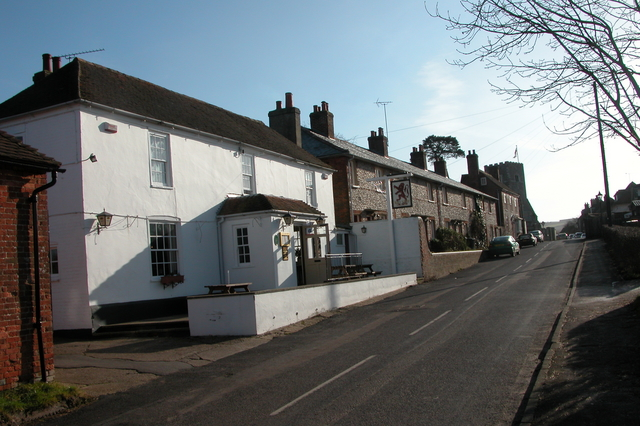 The Red Lion, with St James' church in the background, Southwick.