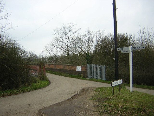 Signpost near railway bridge over the line to Sudbury