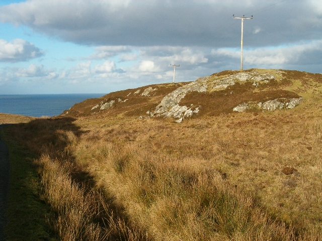Craggy ground with electricity poles