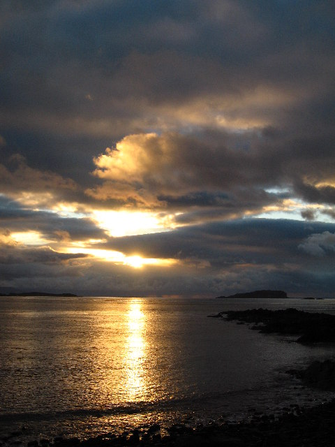 Sun setting to the west of Easdale Island